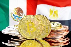 Bitcoins on Mexico and Egypt flag background. Concept for investors in cryptocurrency and Blockchain technology in the Mexico and Egypt. Bitcoins on the royalty free stock image