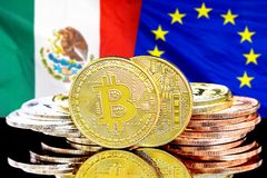 Bitcoins on Mexico and European Union flag background. Concept for investors in cryptocurrency and Blockchain technology in the Mexico and European Union stock photography