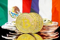 Bitcoins on Mexico and France flag background. Concept for investors in cryptocurrency and Blockchain technology in the Mexico and France. Bitcoins on the royalty free stock photos