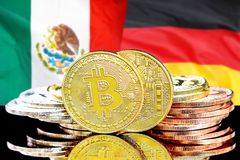 Bitcoins on Mexico and Germany flag background. Concept for investors in cryptocurrency and Blockchain technology in the Mexico and Germany. Bitcoins on the stock photos