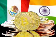 Bitcoins on Mexico and India flag background. Concept for investors in cryptocurrency and Blockchain technology in the Mexico and India. Bitcoins on the royalty free stock photos