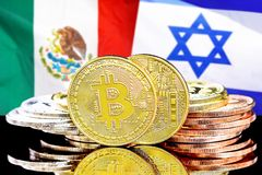 Bitcoins on Mexico and Israel flag background. Concept for investors in cryptocurrency and Blockchain technology in the Mexico and Israel. Bitcoins on the royalty free stock photos
