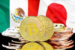 Bitcoins on Mexico and Japan flag background. Concept for investors in cryptocurrency and Blockchain technology in the Mexico and Japan. Bitcoins on the stock photo