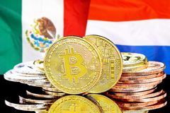 Bitcoins on Mexico and Netherlands flag background. Concept for investors in cryptocurrency and Blockchain technology in the Mexico and Netherlands. Bitcoins on stock photos
