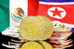 Bitcoins on Mexico and North Korea flag background. Concept for investors in cryptocurrency and Blockchain technology in the Mexico and North Korea. Bitcoins on royalty free stock photos