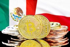 Bitcoins on Mexico and Poland flag background. Concept for investors in cryptocurrency and Blockchain technology in the Mexico and Poland. Bitcoins on the royalty free stock images