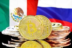 Bitcoins on Mexico and Russia flag background. Concept for investors in cryptocurrency and Blockchain technology in the Mexico and Russia. Bitcoins on the stock photography