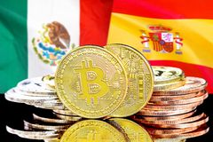 Bitcoins on Mexico and Spain flag background. Concept for investors in cryptocurrency and Blockchain technology in the Mexico and Spain. Bitcoins on the stock photography