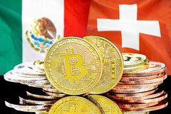 Bitcoins on Mexico and Switzerland flag background. Concept for investors in cryptocurrency and Blockchain technology in the Mexico and Switzerland. Bitcoins on royalty free stock image