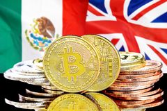 Bitcoins on Mexico and UK flag background. Concept for investors in cryptocurrency and Blockchain technology in the Mexico and United Kingdom. Bitcoins on the royalty free stock photo