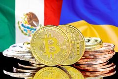 Bitcoins on Mexico and Ukraine flag background. Concept for investors in cryptocurrency and Blockchain technology in the Mexico and Ukraine. Bitcoins on the stock photos
