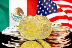 Bitcoins on Mexico and USA flag background. Concept for investors in cryptocurrency and Blockchain technology in the Mexico and United States of America royalty free stock images