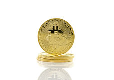 Bitcoins with mobile phone Royalty Free Stock Photos