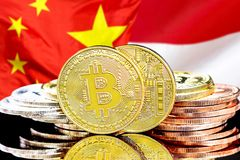 Bitcoins on Monaco and China flag background. Concept for investors in cryptocurrency and Blockchain technology in the Monaco and China. Bitcoins on the royalty free stock image