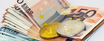 Bitcoins is a monetary denominations of 100 and 50 euros. Golden bitcoins is a monetary denominations of 100 and 50 euros royalty free stock image