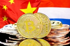 Bitcoins on Netherlands and China flag background. Concept for investors in cryptocurrency and Blockchain technology in the Netherlands and China. Bitcoins on stock image