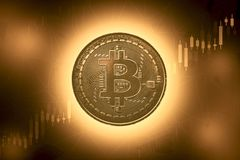 Bitcoins and New Virtual money concept.Gold bitcoin with Candle stick graph chart and digital background.Golden coin with icon royalty free stock photo