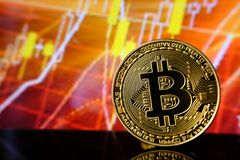 Gold bitcoins with Candle stick graph chart and digital background. Stock Photos