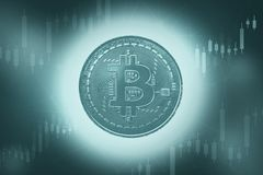 Bitcoins and New Virtual money concept. Green bitcoin with Candle stick graph chart and digital background.Golden coin stock images