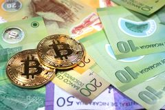 Bitcoins on Nicaragua currency Stock Photos