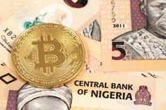 Bitcoins with Nigerian naira close up Stock Photos