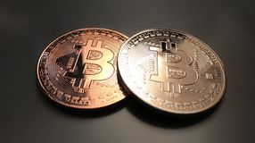 Bitcoins no fundo neutro Fotografia de Stock Royalty Free