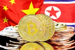 Bitcoins on North Korea and China flag background. Concept for investors in cryptocurrency and Blockchain technology in the North Korea and China. Bitcoins on stock photography