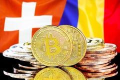 Bitcoins op de vlagachtergrond van Zwitserland en van Moldavië stock foto
