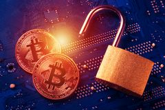 Bitcoins with opened padlock on computer motherboard. Crypto currency Internet data privacy information security concept. stock image