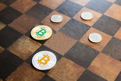 Bitcoins are opposed to dollars in stock photos