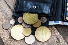 Bitcoins in personal wallet royalty free stock images