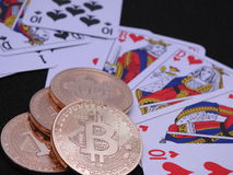 Bitcoins and playing cards Royalty Free Stock Photography