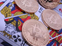 Bitcoins and playing cards. Royalty Free Stock Images