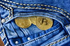 Bitcoins in pocket Royalty Free Stock Images