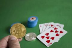 Bitcoins on poker table royalty free stock images