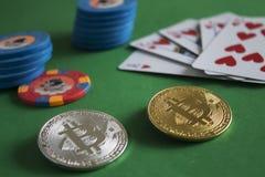 Bitcoins on poker table royalty free stock photos