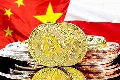 Bitcoins on Poland and China flag background. Concept for investors in cryptocurrency and Blockchain technology in the Poland and China. Bitcoins on the stock photography