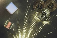Bitcoins with prisms. And light beams royalty free stock photography