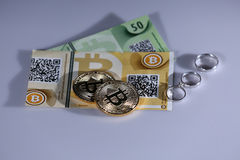 Bitcoins and rings Royalty Free Stock Photo