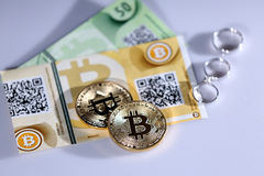 Bitcoins and rings Stock Photography