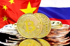 Bitcoins on Russia and China flag background. Concept for investors in cryptocurrency and Blockchain technology in the Russia and China. Bitcoins on the stock photo