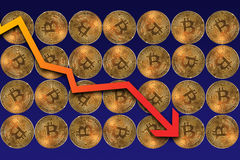 Bitcoins share prices fall. Bitcoins with arrow pointing down explaining share prices fall royalty free stock photo
