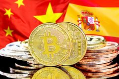 Bitcoins on Spain and China flag background. Concept for investors in cryptocurrency and Blockchain technology in the Spain and China. Bitcoins on the background royalty free stock photos