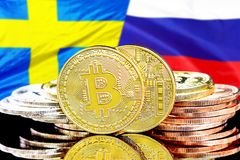 Bitcoins on Sweden and Russia flag background. Concept for investors in cryptocurrency and Blockchain technology in the Sweden and Russia. Bitcoins on the stock images