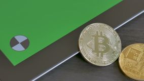 Bitcoins and tablet with a green screen for your content stock footage