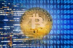 Bitcoins on technology background Royalty Free Stock Photo