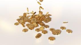 Bitcoins tombant sur une pile Photo stock