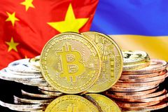 Bitcoins on Ukraine and China flag background. Concept for investors in cryptocurrency and Blockchain technology in the Ukraine and China. Bitcoins on the stock photos