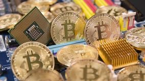 Bitcoins virtual currency pile. On computer mother board stock video footage