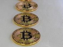 Bitcoins on white Background. Three Bitcoins on white soft background royalty free stock image